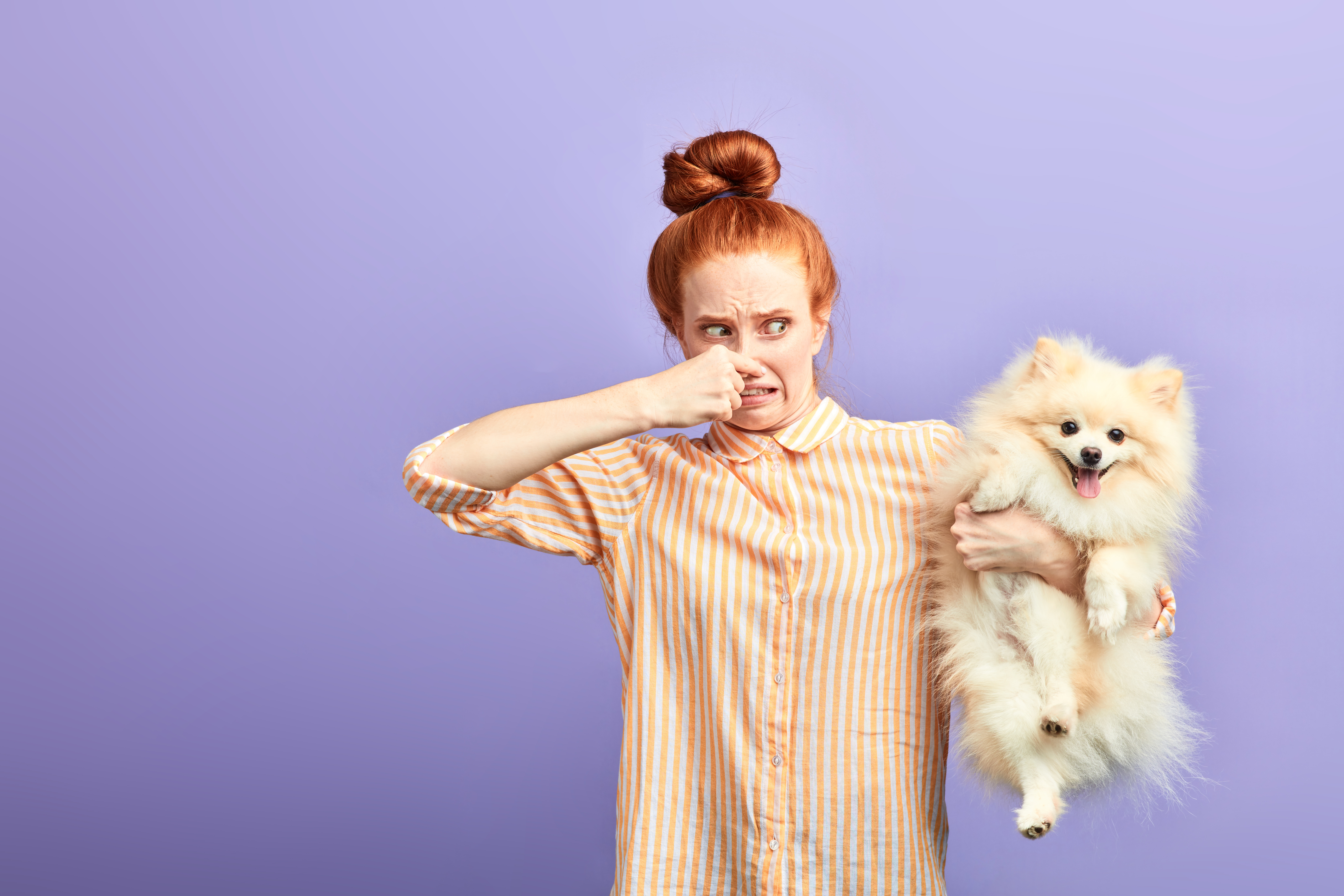 angry frustrated girl holding stinky dog